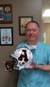 Anchorage dentist high school football sponsors.